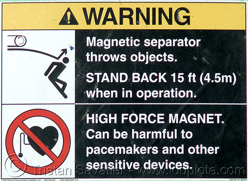 warning sign on concrete shredder - strong magnetic field - danger - building demolition, building demolition, concrete shredder, danger, hazard, magnet, magnetic field, magnetic separator, sign, stick figure, warning