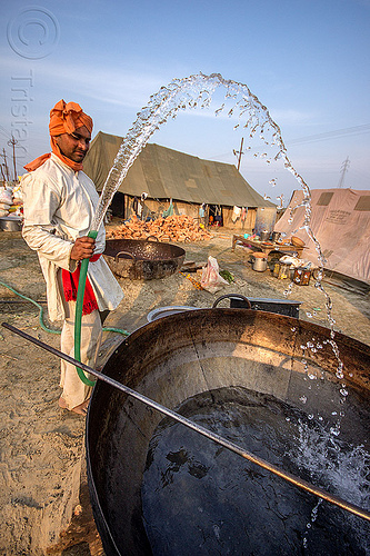 washing a large cooking pot at kumbh mela 2013 (india), ashram, big, cooking pot, hindu pilgrimage, hinduism, huge, large, maha kumbh mela, man, washing, water droplets, water hose