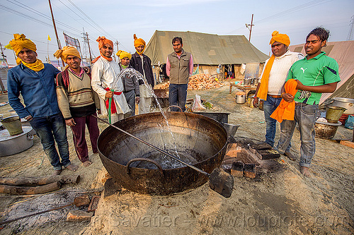 washing a large cooking pot in an ashram (india), ashram, big, cooking pot, group, hindu pilgrimage, hinduism, huge, india, large, maha kumbh mela, men, washing, water hose