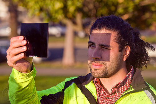 watching the transit of venus 2012, 2012, dolores park, eclipse filter, holding, man, planet venus, shade, shadow, solar filter, transit of venus, venus transit, watching, welding filter