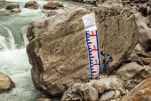 water level gauge painted on huge boulder in mountain stream (india), alaknanda river, alaknanda valley, flowing, hydrometric, india, man, mountains, painted, staff gauge, standing, water level, whitewater