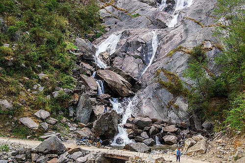 waterfall in the kali gandaki valley (nepal), annapurnas, cascade, cliff, dirt road, falls, kali gandaki valley, motorbike, motorcycle, mountain road, rock, unpaved, water, waterfall