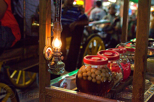 wedang ronde - javaneese sweet desert, food cart, ginger tea, glass jars, indonesia, jogja, malioboro, night, oil lamp, petrol lamp, rice balls, street food, street seller, wedang ronde, yogyakarta