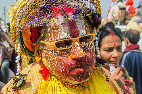 weird guru with face paint - kumbh mela (india), face paint, face painting, glasses, guru, headdress, headwear, hindu, hinduism, kumbh maha snan, kumbha mela, maha kumbh mela, makeup, man, mauni amavasya, tilak, tilaka, veil