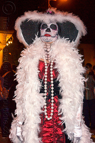 white feather boa - sugar skull makeup, black hat, day of the dead, dia de los muertos, face painting, facepaint, halloween, night, red dress, sugar skull makeup, white beads necklace, white feather boa, white gloves, woman