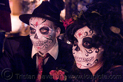 white skull makeup - couple - dia de los muertos - halloween (san francisco), couple, day of the dead, dia de los muertos, face painting, facepaint, halloween, man, night, sugar skull makeup, woman