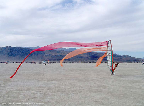 windsurf-burning-man-2004 - landsailing, art, burning man, dust storm, landsailing, speedsail, speedsailing, streamer flags, streamers, street sailing, windsurfing
