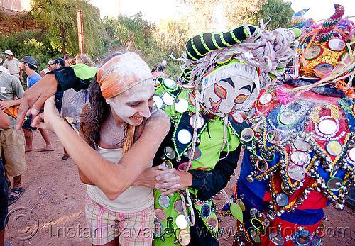 woman dancing with diablos - carnaval de tilcara (argentina), andean carnival, costume, dancing, diablo carnavalero, diablo de carnaval, folklore, horns, indigenous culture, man, mask, mirrors, noroeste argentino, quebrada de humahuaca, talk powder, tilcara, tribal, woman