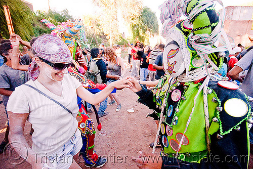 woman dancing with green diablo - carnaval de tilcara (argentina), andean carnival, argentina, colorful, costume, dancing, diablo carnavalero, diablo de carnaval, folklore, indigenous culture, man, mask, mirrors, noroeste argentino, quebrada de humahuaca, quechua culture, tilcara, tribal, woman