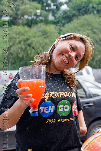 woman holding makeshift cup made with cut soda bottle, andean carnival, carnaval, drink, jujuy capital, noroeste argentino, san salvador de jujuy, woman