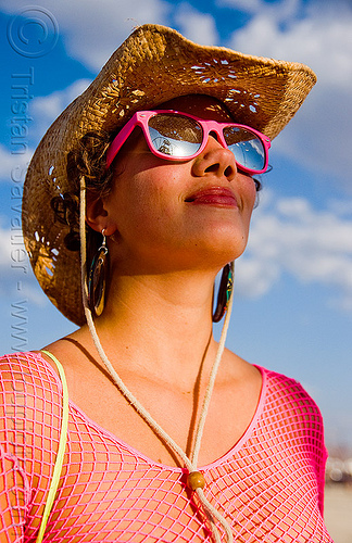 woman in pink fishnet - burning man 2009, burning man, fishnet clothing, fishnet top, straw hat, sunglasses, woman