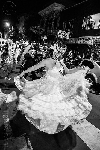 woman in white dress dancing in the street - dia de los muertos, dancing, day of the dead, dia de los muertos, face painting, facepaint, halloween, lace dress, night, sugar skull makeup, white dress, woman