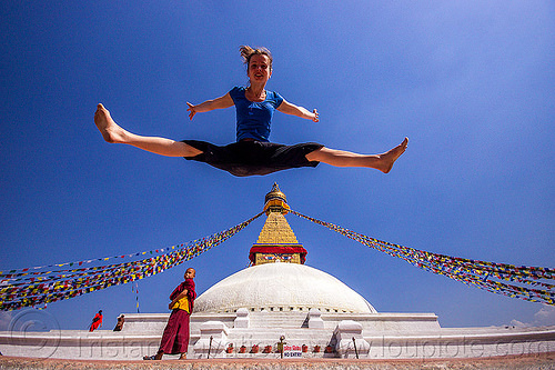 woman jumping over bodnath stupa - boudhanath (nepal), anne-laure, bodnath stupa, boudhanath, buddhism, buddhist monk, jump, jumpshot, kathmandu, man, prayer flags, tibetan, woman