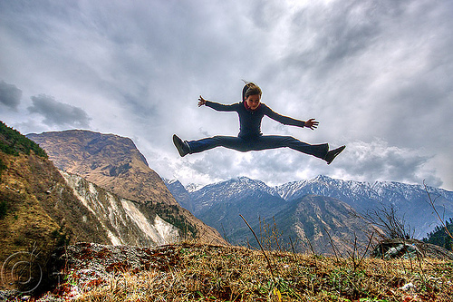 woman jumping over the himalaya mountains (nepal), annapurnas, anne-laure, clouds, cloudy, jump, jumpshot, kali gandaki valley, mountains, woman