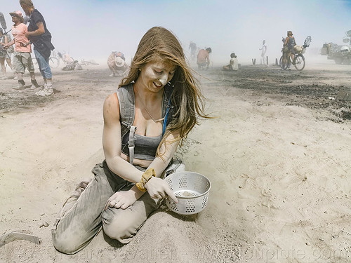 woman looking for quartz in man's ashes - burning man 2019, ashes, burn, burning man, dust, dusty, playa, sifting, the man, woman