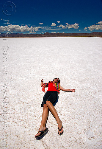 woman lying on salt flat - salinas grandes - salar (argentina), blue sky, charlotte, desert, halite, horizon, jujuy, lying down, noroeste argentino, rock salt, salar, salinas grandes, salt bed, salt flats, salt lake, white, woman