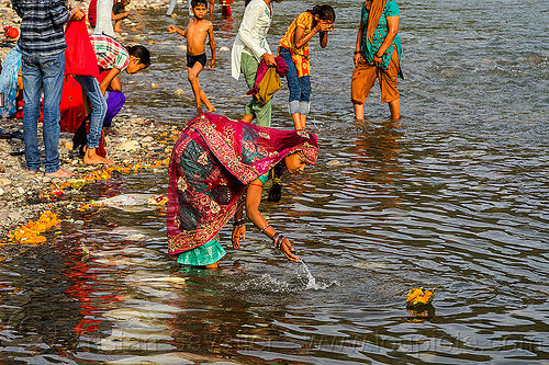 woman making hindu offering in ganges river - triveni ghat - rishikesh (india), floating, ganga river, ganges river, ghats, hinduism, holy bath, holy dip, offering, rishikesh, river bathing, saree, sari, triveni ghat, wading, water, woman