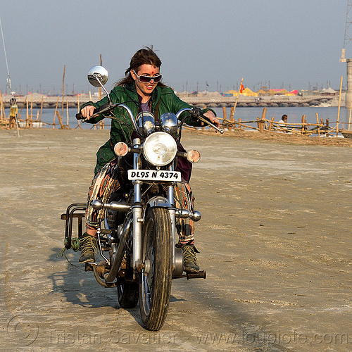 woman riding royal enfield bullet thunderbird motorcycle, 350cc, bun bun, ganga, ganges river, hindu pilgrimage, hinduism, india, maha kumbh mela, motorcycle touring, motorcyclist, rider, riding, royal enfield bullet, thunderbird, woman