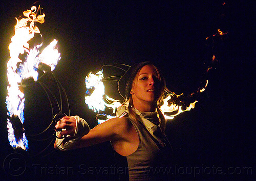 woman spinning fire fans, fire dancer, fire dancing, fire fans, fire performer, flames, joanna, night, woman