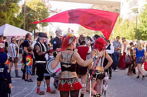 woman with back tattoo waving red flag, back piece, back tattoo, burning man decompression, red flag, street, tattooed, tattoos, waving, woman