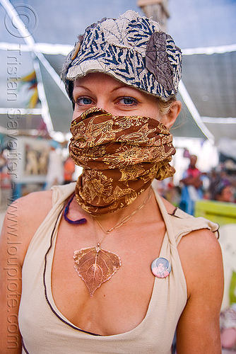 woman with bandana at the center camp cafe - burning man 2009, burning man, cap, hat, leaf necklace, woman, yellow bandana