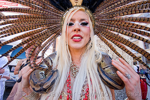 woman with boa snake - feather headdress, blonde, boa snake, carnival, costume, feather headdress, feathers, how weird festival, woman