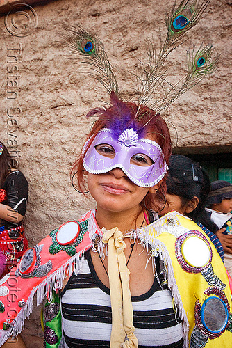 woman with carnival mask - carnaval de humahuaca (argentina), andean carnival, costume, diabla, diablo, diablo carnavalero, diablo de carnaval, feathers, folklore, horns, indigenous, indigenous culture, mirrors, noroeste argentino, peacock feathers, people, quebrada de humahuaca, tribal
