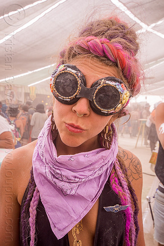 woman with decorated goggles and pink bandana at center camp - burning man 2015, bandana, braided hair, center camp, earrings, goggles, pink, rose tattoo, shoulder tattoo, woman