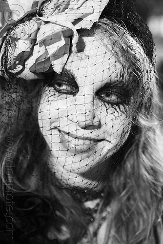 woman with face veil - Día de los muertos - halloween (san francisco), day of the dead, dia de los muertos, face painting, face veil, facepaint, flower headdress, flower headwear, halloween, makeup, night, people, woman