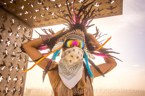 woman with feather headdress - burning man 2015, bandana, burning man, dust storm, face mask, feather headdress, feathers, pia, white out, windy, woman