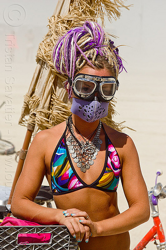 woman with motorcycle goggles and dust mask - burning man 2013, burning man, dreads, dust mask, metal necklace, motorcycle goggles, purple dreadlocks, woman