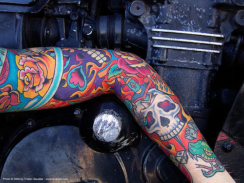 woman with skull and roses arm tattoo (san francisco), arm, colorful, motorcycle engine, rose tattoo, skin, skull tattoo, tattooed, tattoos, woman