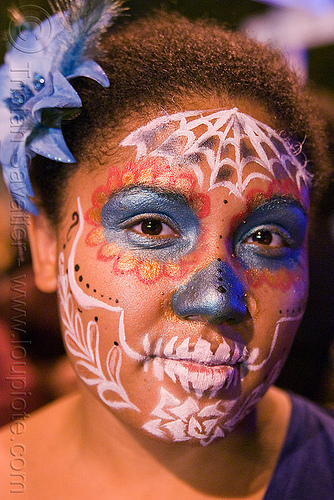 woman with skull makeup - Día de los muertos - halloween (san francisco), blue flower, day of the dead, dia de los muertos, face painting, facepaint, flower headdress, flower headwear, halloween, night, sugar skull makeup, woman