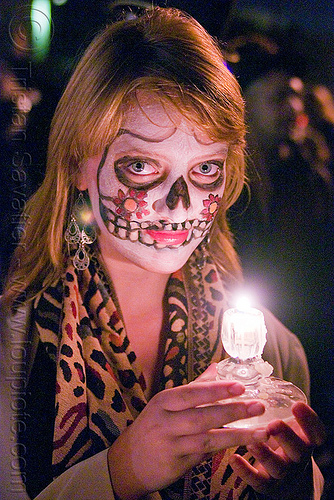 woman with skull makeup holding candle - Día de los muertos - halloween (san francisco), candle light, day of the dead, dia de los muertos, face painting, facepaint, halloween, night, sugar skull makeup, woman