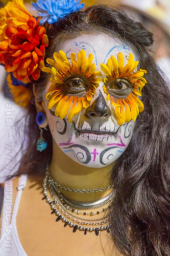 woman with sugar skull makeup and flower eyes, day of the dead, dia de los muertos, face painting, facepaint, flower headdress, flowers, halloween, necklaces, night, orange color, people