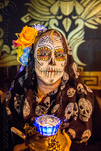woman with sugar skull makeup - kara - dia de los muertos, black veil, blue, candle, day of the dead, dia de los muertos, face painting, facepaint, flower headdress, flowers, halloween, mural, night, orange rose flower, skulls pattern, sugar skull makeup, woman