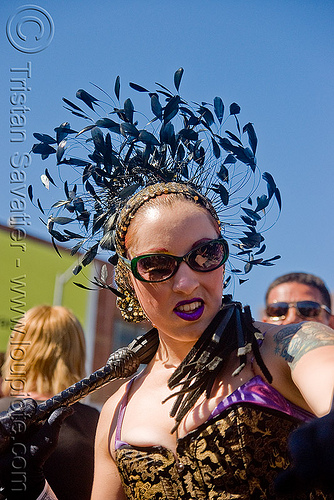 woman with whip - dore alley fair (san francisco), feather hat, feathers, leather whip, woman