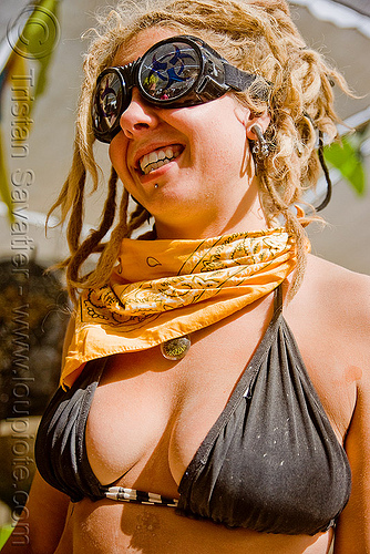 woman with yellow bandana and goggles - burning man 2009, blonde, burning man, goggles, woman, yellow bandana
