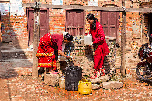women getting water from well (nepal), bhaktapur, jerrycans, jugs, people, plastic, plastic jerrycans, plastic jugs, pouring, pulley, ropes, water well