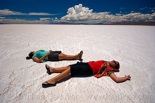 women lying on salt flat - salinassalinas grandes - salar (argentina), blue sky, camille, charlotte, desert, halite, horizon, jujuy, lying down, noroeste argentino, rock salt, salar, salinas grandes, salt bed, salt flats, salt lake, two, white, women