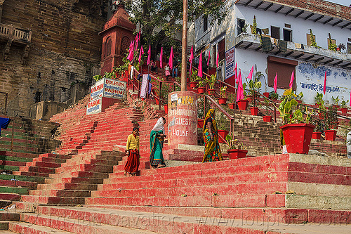 women walking on red-painted ghats - varanasi (india), dolphin restaurant, ghats, india, painted, pink flags, rashmi guest house, red color, red ghat, red steps, stairs, varanasi, walking, women
