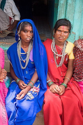 women with chainmail necklaces (india), blue, chainmail, jewellery, metal, necklaces, nose piercing, nose ring, nostril piercing, red, sailana, saree, sari, sitting, two, women
