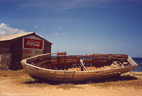wooden boat wreck on the beach, abandoned, boat cemetery, coca cola, decaying boat, disused, ocean, old, rotten, sea, ship cemetery, small boat