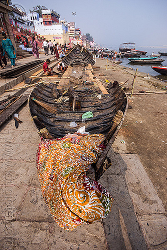 wooden riverboat construction - ghats of varanasi (india), construction, fixing, ganga, ganges river, ghats, hull, india, men, repairing, river bank, river boat, varanasi