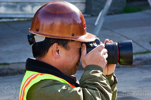 worker taking photos on construction site, camera, construction worker, duboce, high-visibility jacket, high-visibility vest, light rail, man, muni, ntk, photographer, railroad construction, railroad tracks, rails, railway tracks, reflective jacket, reflective vest, safety helmet, safety vest, san francisco municipal railway, track maintenance, track work