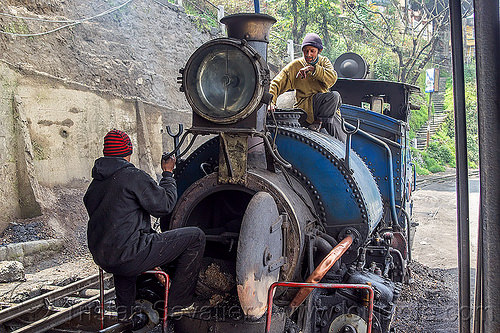 workers inspecting the boiler of a steam locomotive - darjeeling (india), 791, darjeeling himalayan railway, darjeeling toy train, fixing, men, narrow gauge, people, railroad, repairing, steam engine, steam train engine, train depot, train yard