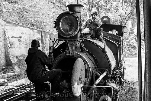 workers inspecting the boiler of a steam locomotive - darjeeling (india), 791, boiler, darjeeling himalayan railway, darjeeling toy train, fixing, india, men, narrow gauge, railroad, repairing, steam engine, steam locomotive, steam train engine, train depot, train yard, workers