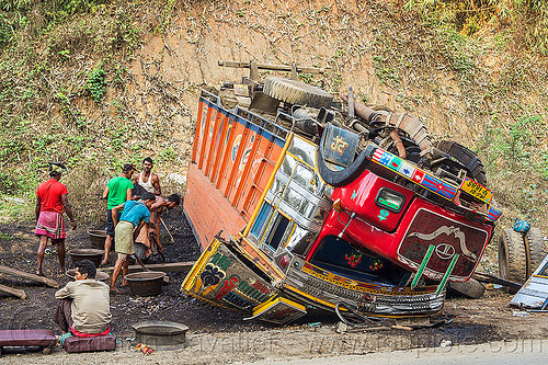 workers unloading overturned truck (india), accident, cab, cabin, coal, crash, crushed, ditch, lorry, men, people, road, rollover, shoveling, tata, tata motors, traffic accident, truck accident, up-side-down, working, wreck