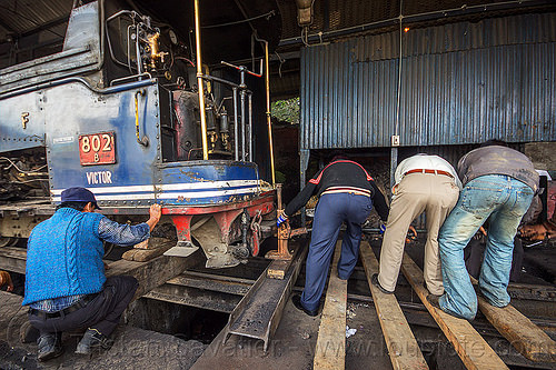 workers using mechanical lift to raise steam locomotive - darjeeling (india), 802 victor, 902, darjeeling himalayan railway, darjeeling toy train, india, lift, lifting, men, narrow gauge, railroad, steam engine, steam locomotive, steam train engine, train depot, train yard, workers, working