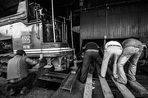 workers using mechanical lift to raise steam locomotive - darjeeling (india), 802 victor, 902, darjeeling himalayan railway, darjeeling toy train, lift, lifting, men, narrow gauge, people, railroad, steam engine, steam locomotive, steam train engine, train depot, train yard, workers, working